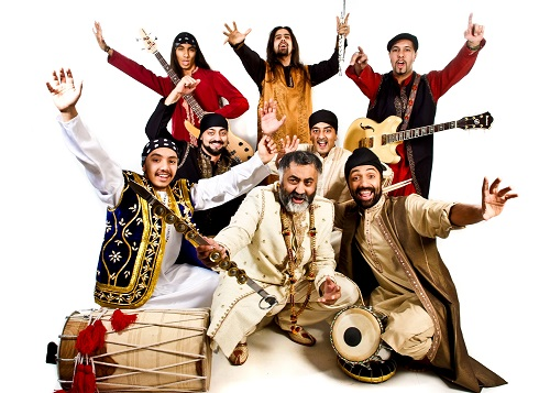 A bhangra band in cosutme with musical instruments