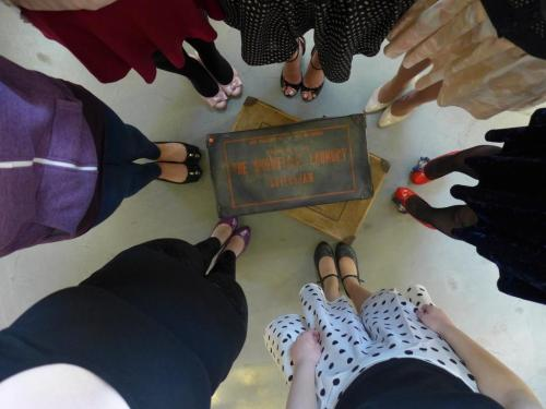 Looking down at a group of feet in 1950s shoes