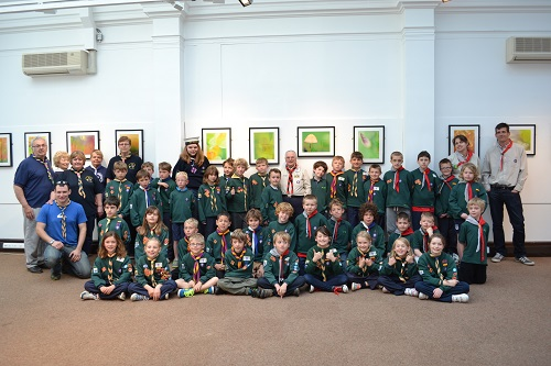 A pack of scouts in a museum