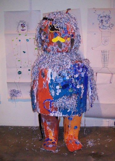 A large cardboard monster made by children