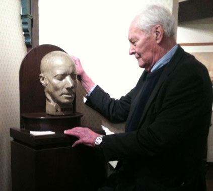 A man face to face with a bust