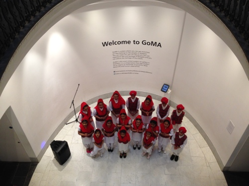 A Sikh children's choir in a gallery