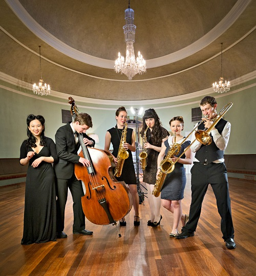 A group of musicians in a historic house