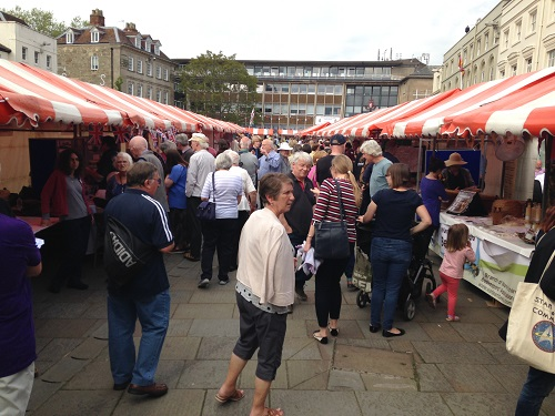 A group of people visiting market stalls